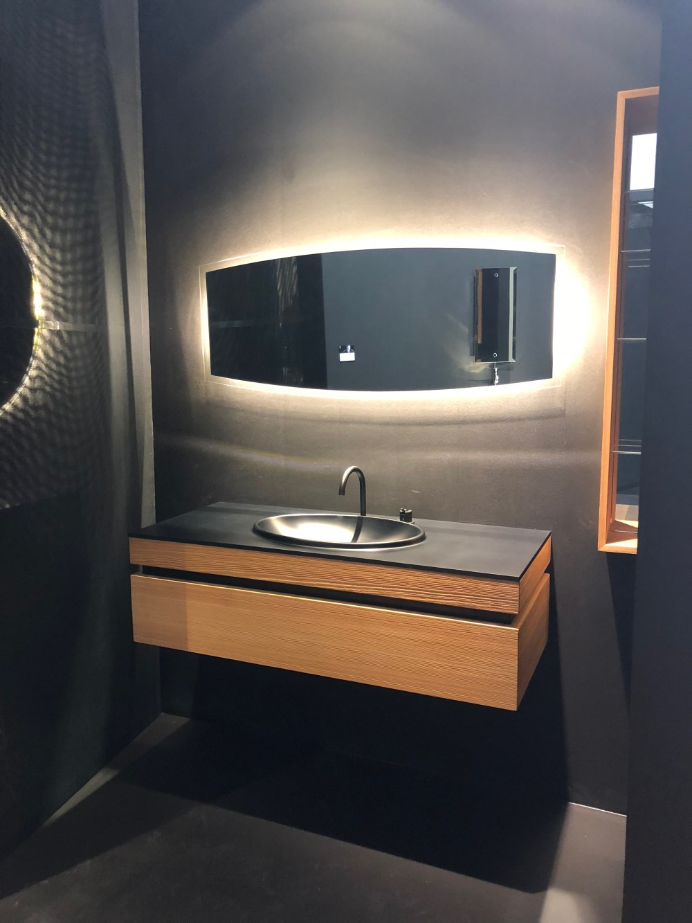There's usually a strong connection between a bathroom vanity and the mirror, these often being complementary of one another