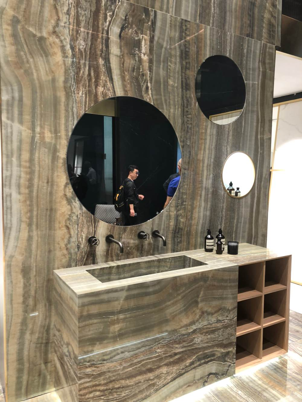 A bathroom vanity can either stand out and become a focal point or it can blend in with the wall behind it and the rest of the bathroom