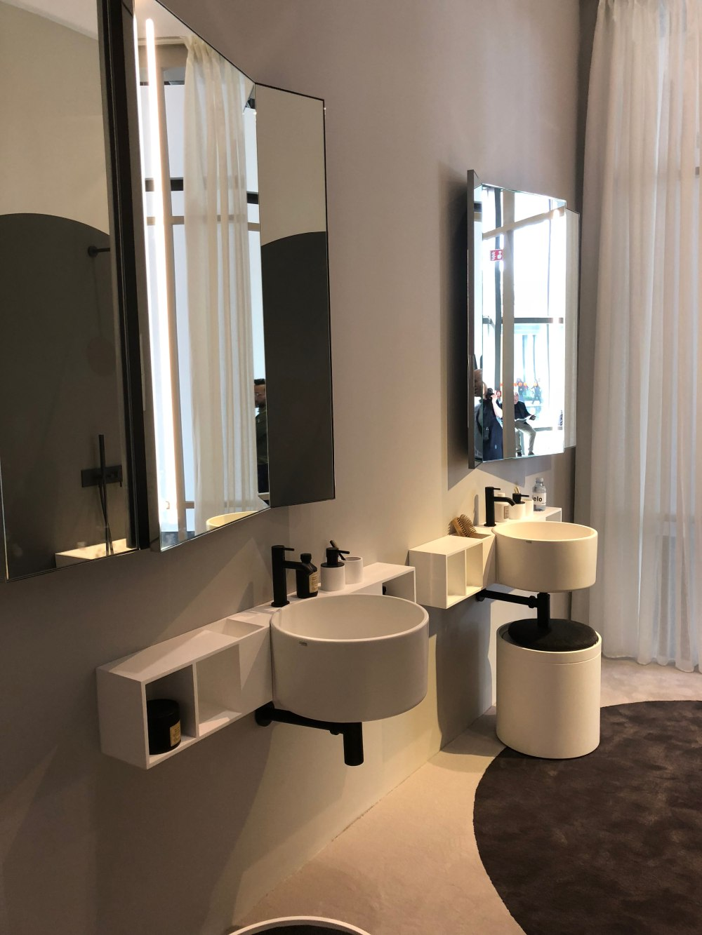 The design and geometry of both the vanities and the mirror add a lot of character to the room