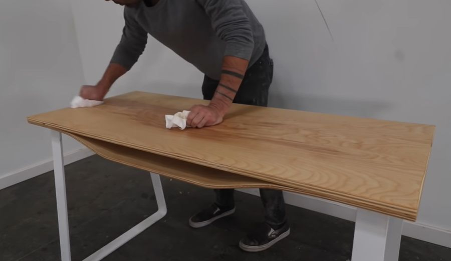 Plywood desk with a curved shelf