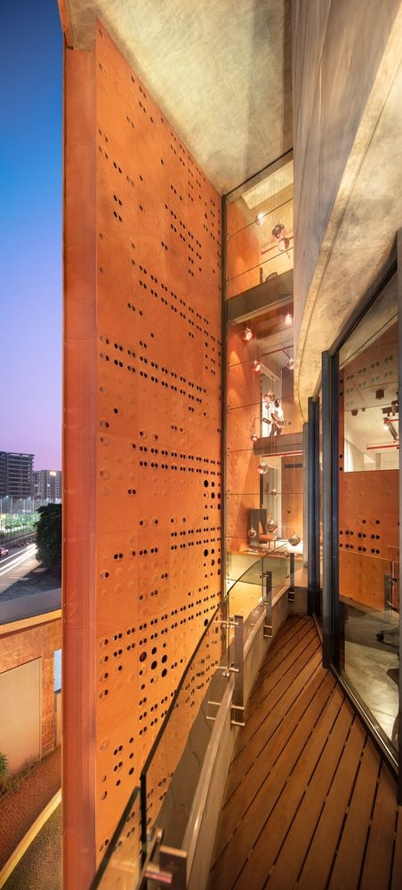 The perforated facade lets light through and creates a beautiful backdrop