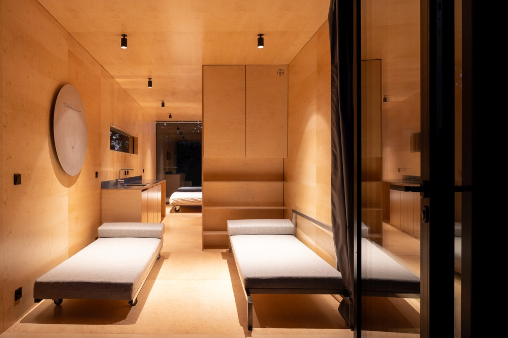 Two double bedrooms occupy the rear section of the cabin