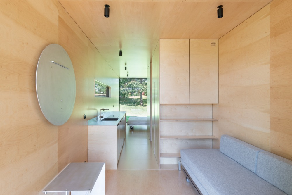 The interior of the cabin is warm and cozy thanks to all the natural plywood
