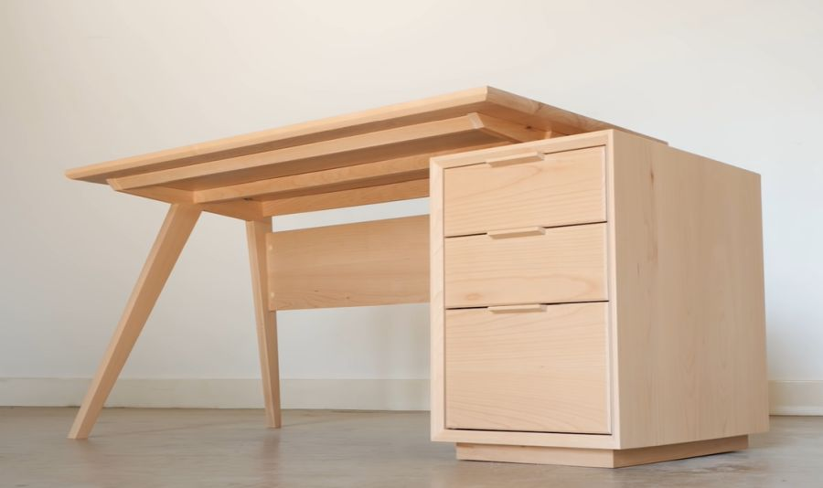 Stylish desk with tapered legs and side cabinet