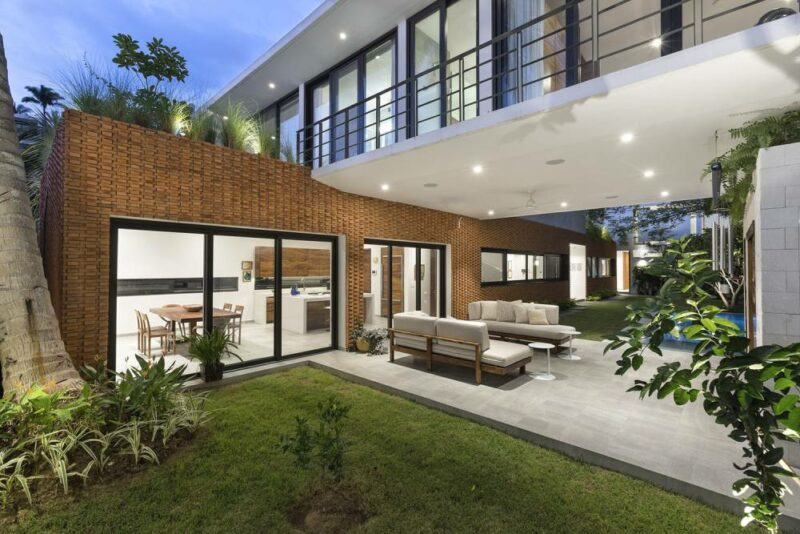 A Tropical House With Beautiful Walls Of Brick And Concrete