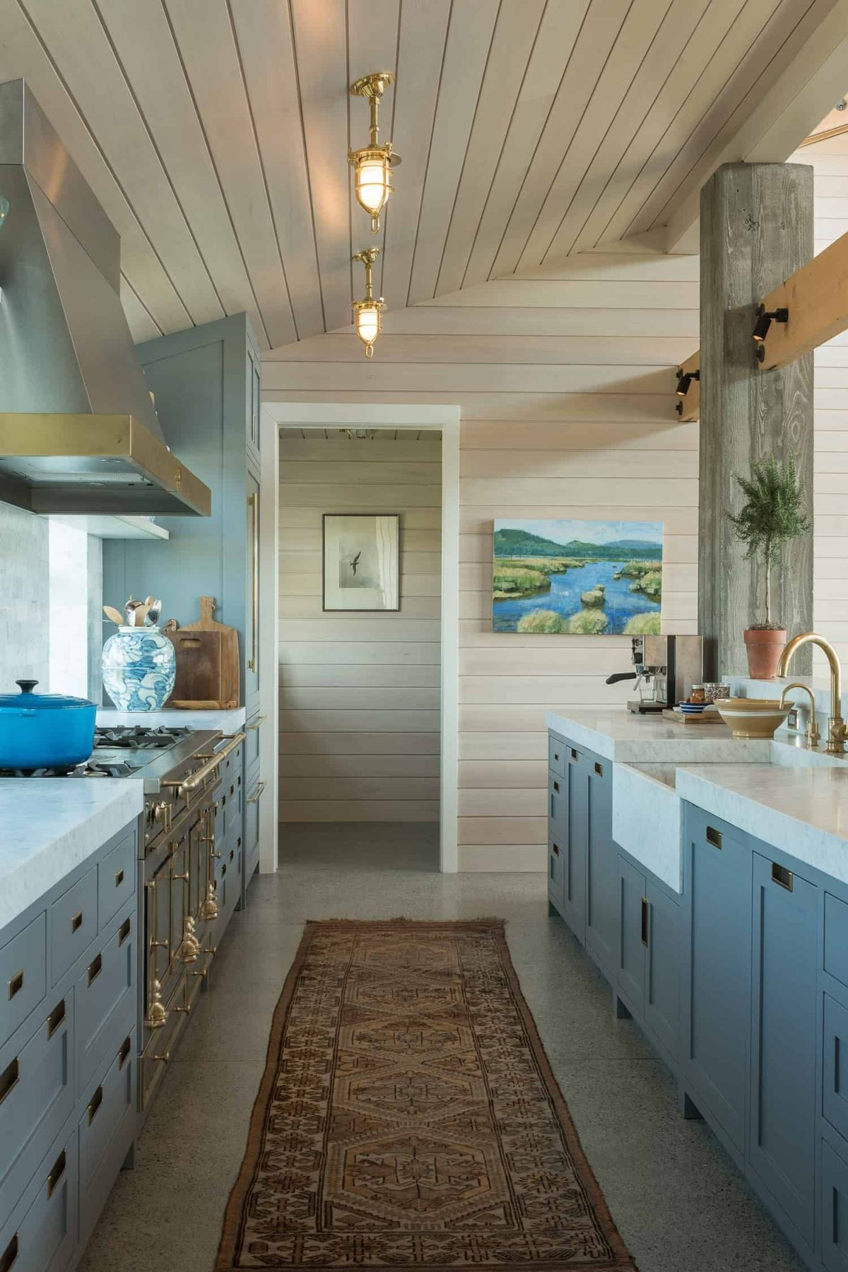 The kitchen is a very inviting space with a retro design and elegant marble countertops