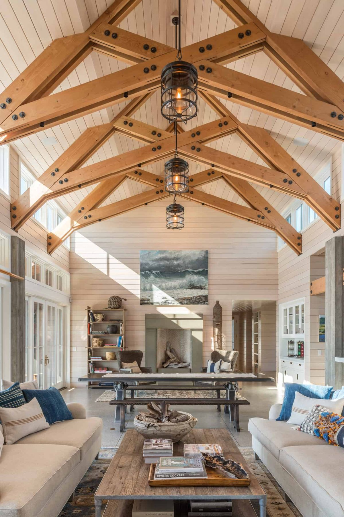 The ceiling beams stand out and contrast with the whitewashed spruce cladding on the walls and ceiling