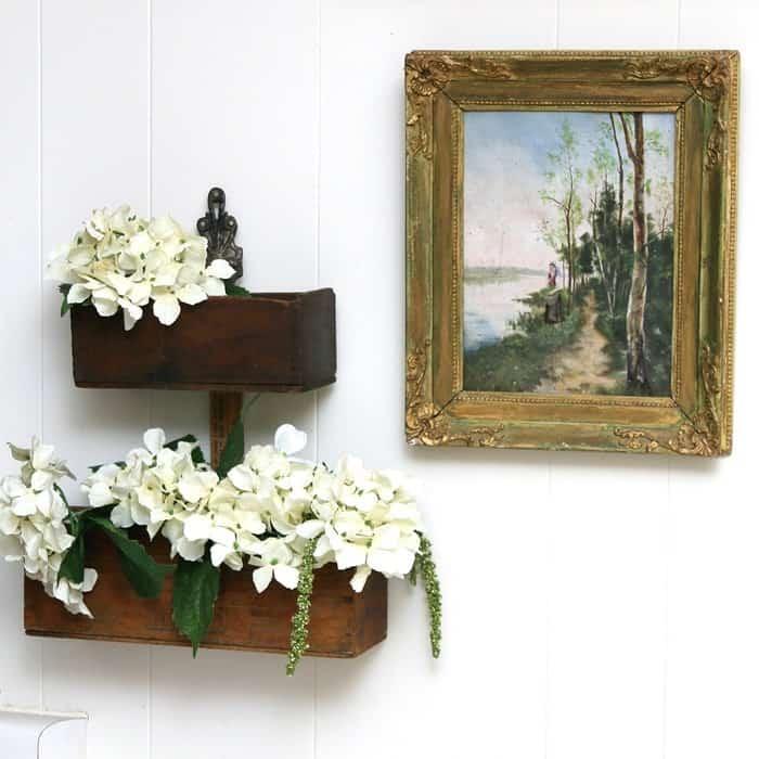 Flower display shelves made of repurposed wood boxes