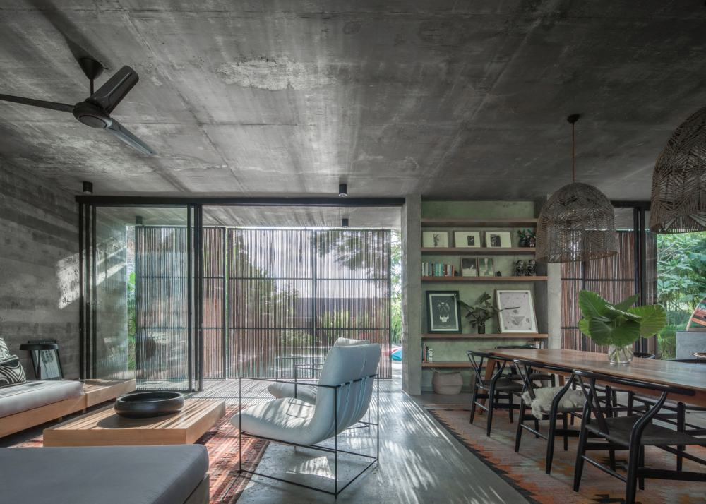 The large windows and sliding glass doors compensate for the cold nature of the concrete walls and ceilings