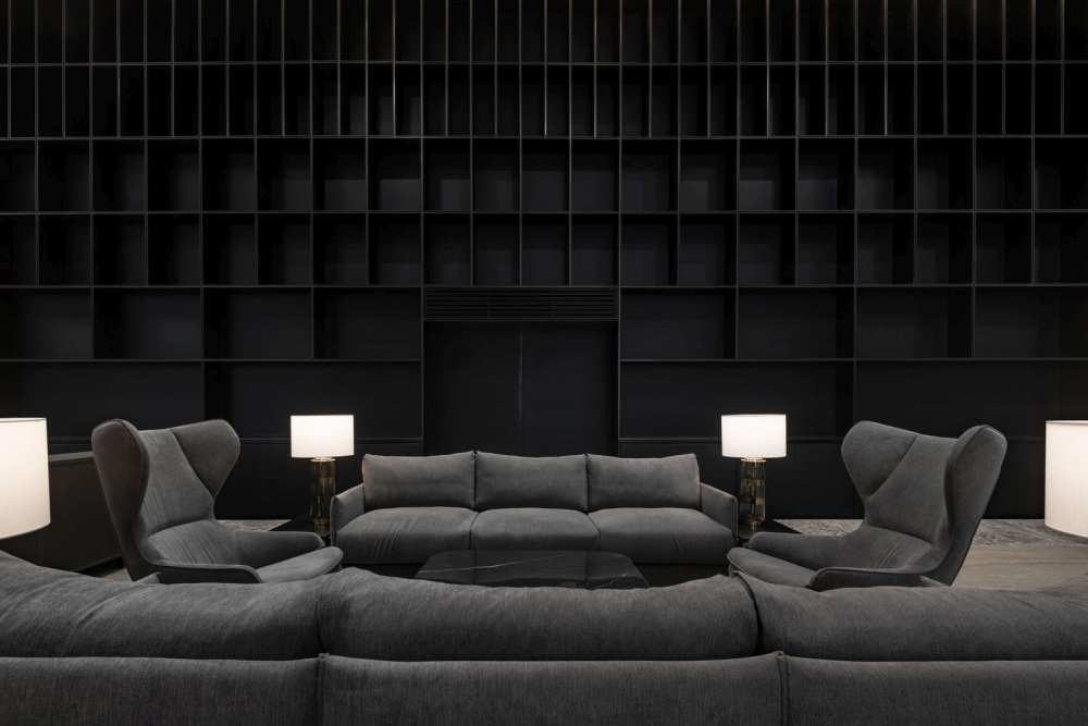 Additional spaces such as this casual lounge area also add a residential feel to the office