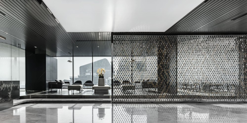 A very open feel is maintained throughout the entire office and even some of the dividing walls are made out of perforated metal panels