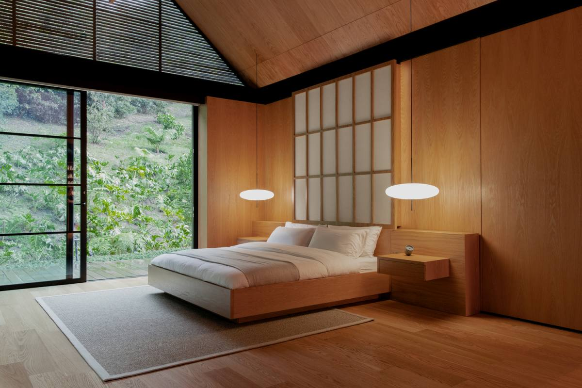 A minimalist approach with Japanese design accents gives this bedroom a very relaxing and calming ambiance