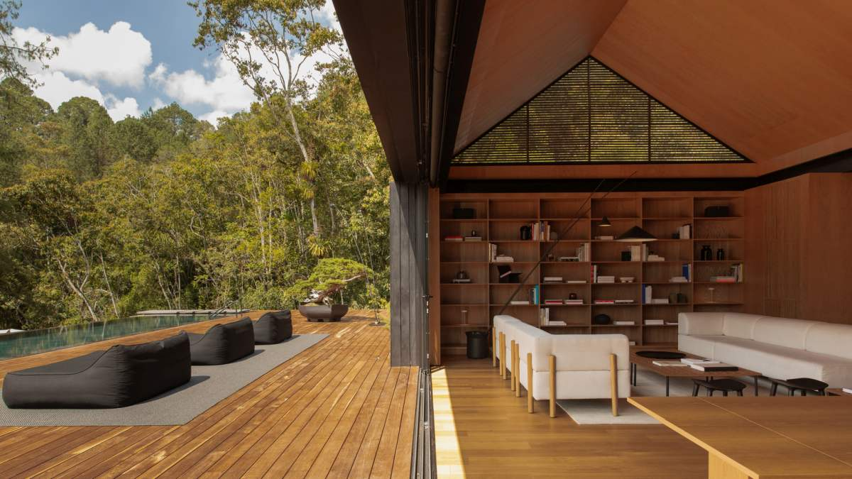 The transition from inside the house to the open deck is a smooth one thanks to the use of wood as a flooring material