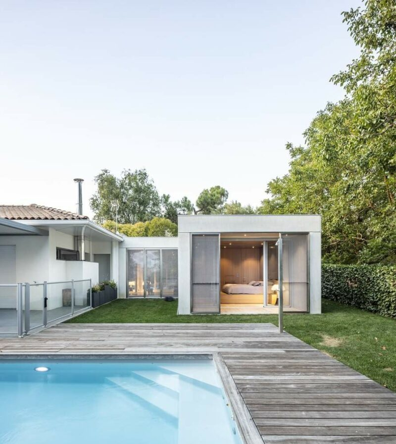 Contemporary House Extension In France With Metal Screens And A Home Gym