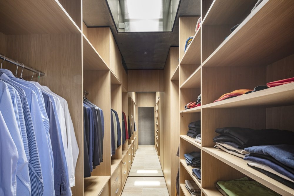 The walk-in closet is large and offers lots of storage. It also has a mirror which tricks the eye