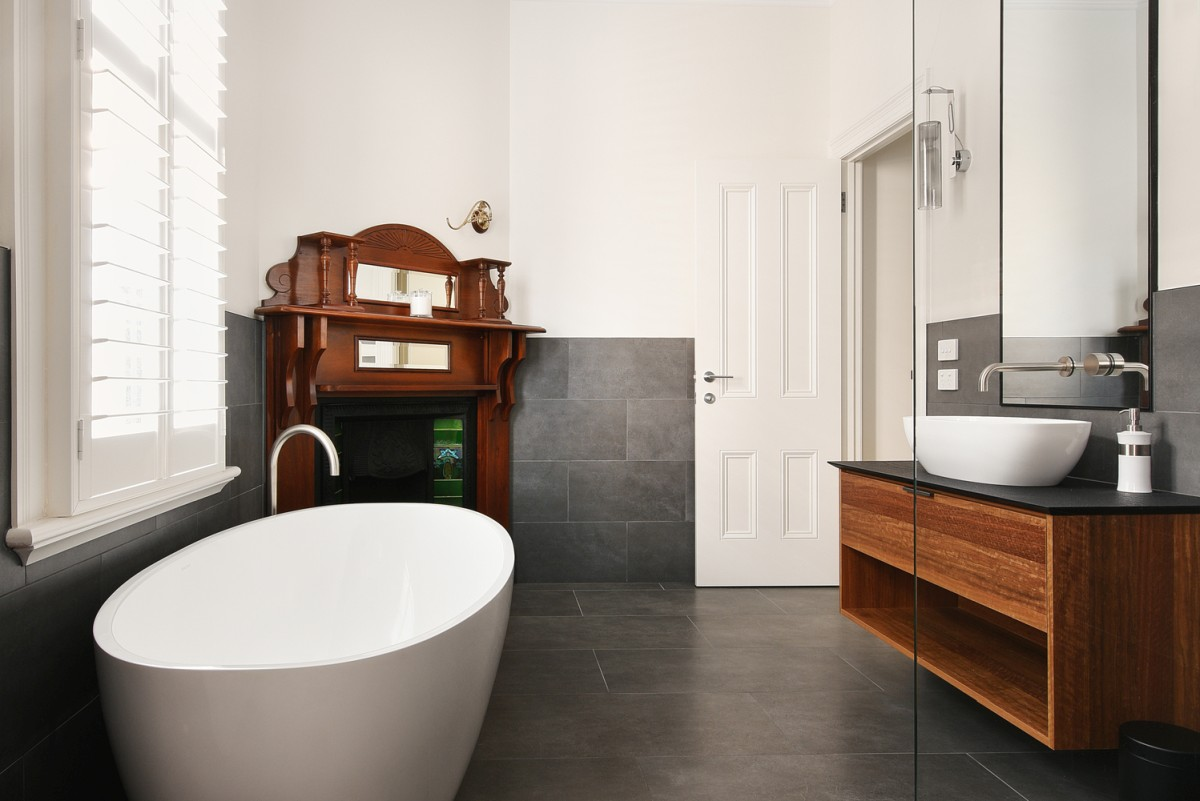 The master bathroom used to be a bedroom and still has this beautiful Edwardian fireplace