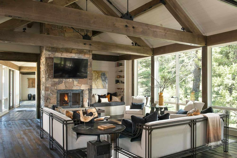 A beautiful stone fireplace reinforces the rustic vibe of the living room and makes it feel extra cozy