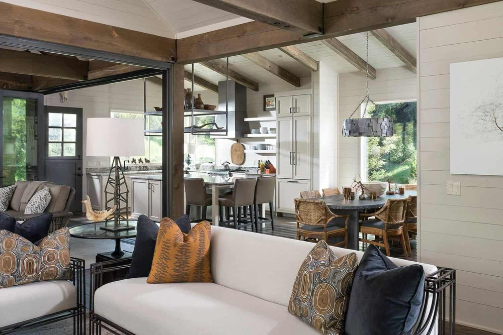 The stylish off-white and light neutrals are mixed in with earthy browns and wood and metal for an eclectic feel