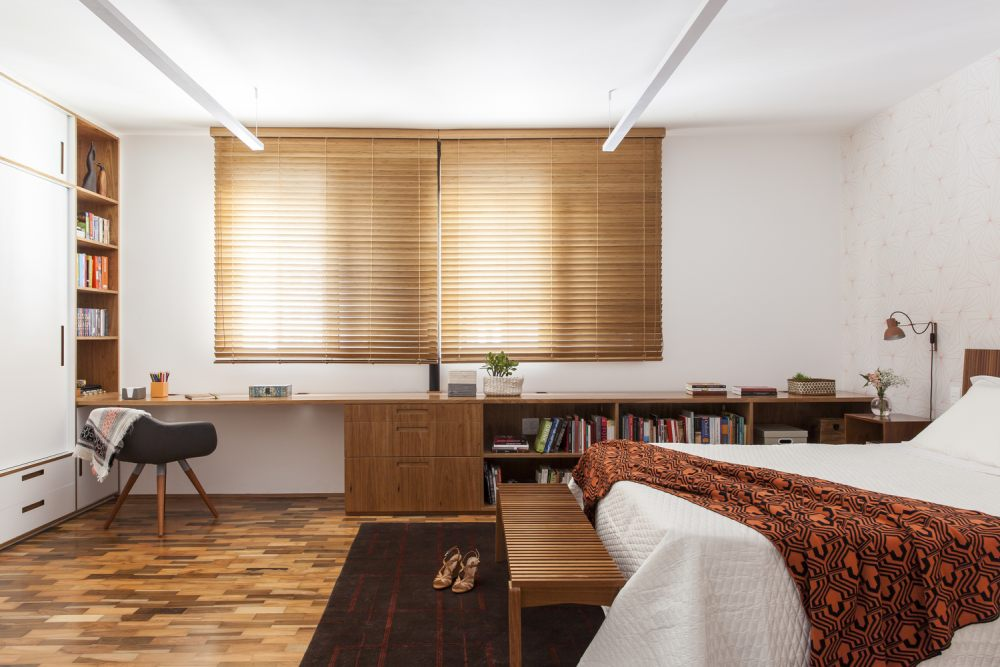 The two small bedrooms were combined into a single large one with a warm and welcoming decor