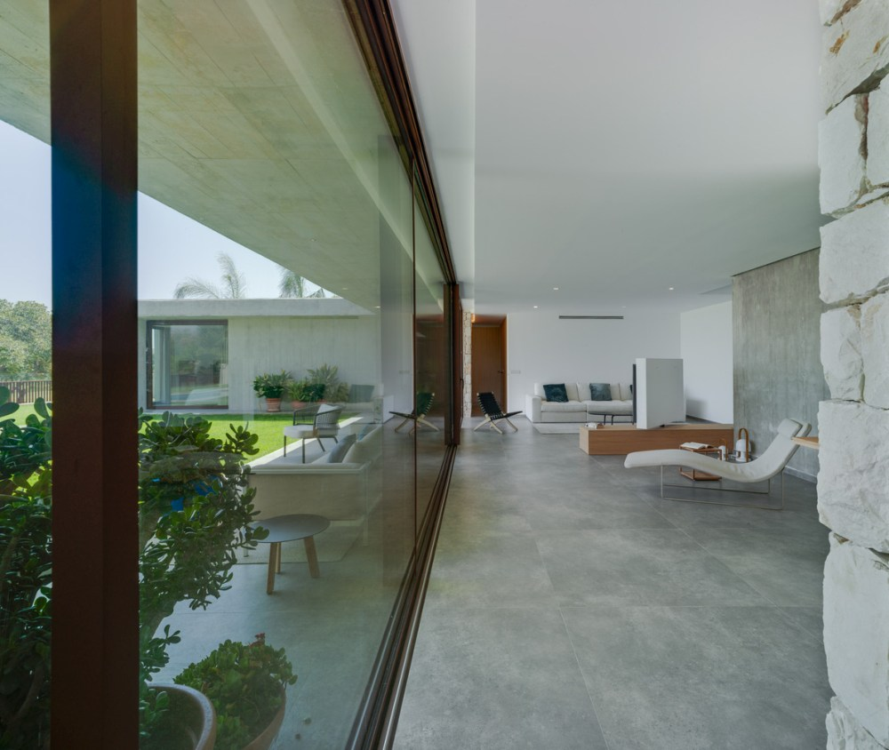 Polished concrete floors and white walls create a contemporary aesthetic and put an emphasis on the views