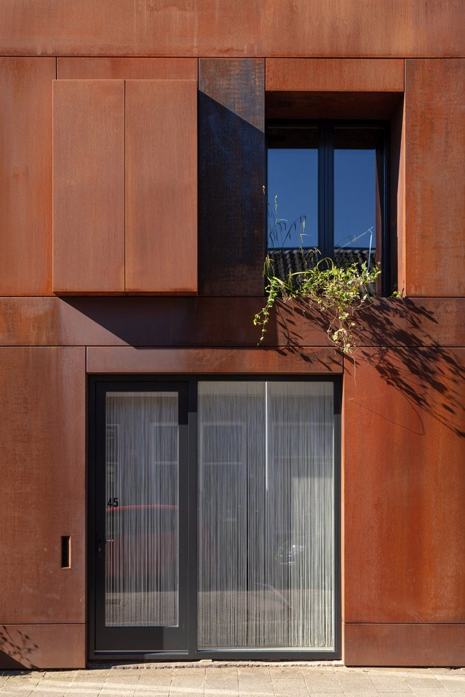 The exterior of the building is clad in Corten steel, a material that makes a strong and lasting impression