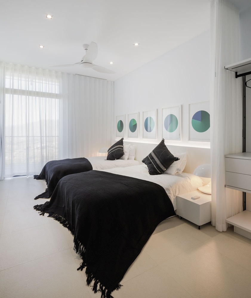 All four bedrooms are minimalistic and have identical structures with monochrome interiors