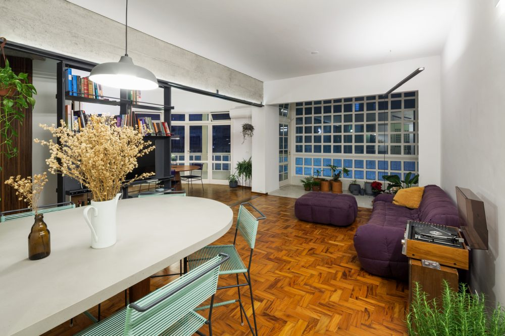 The wooden parquet floor becomes a focal point for the whole apartment