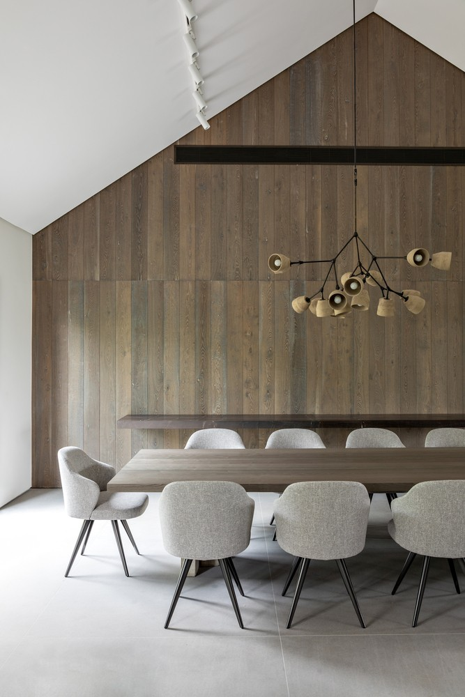 One of three buildings houses the social areas, including this elegant dining room