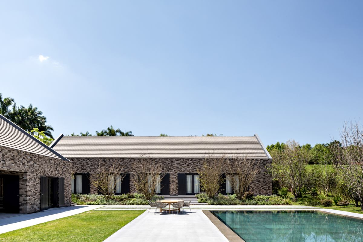 The buildings also frame a large and beautiful backyard with a swimming pool and plenty of space to go around