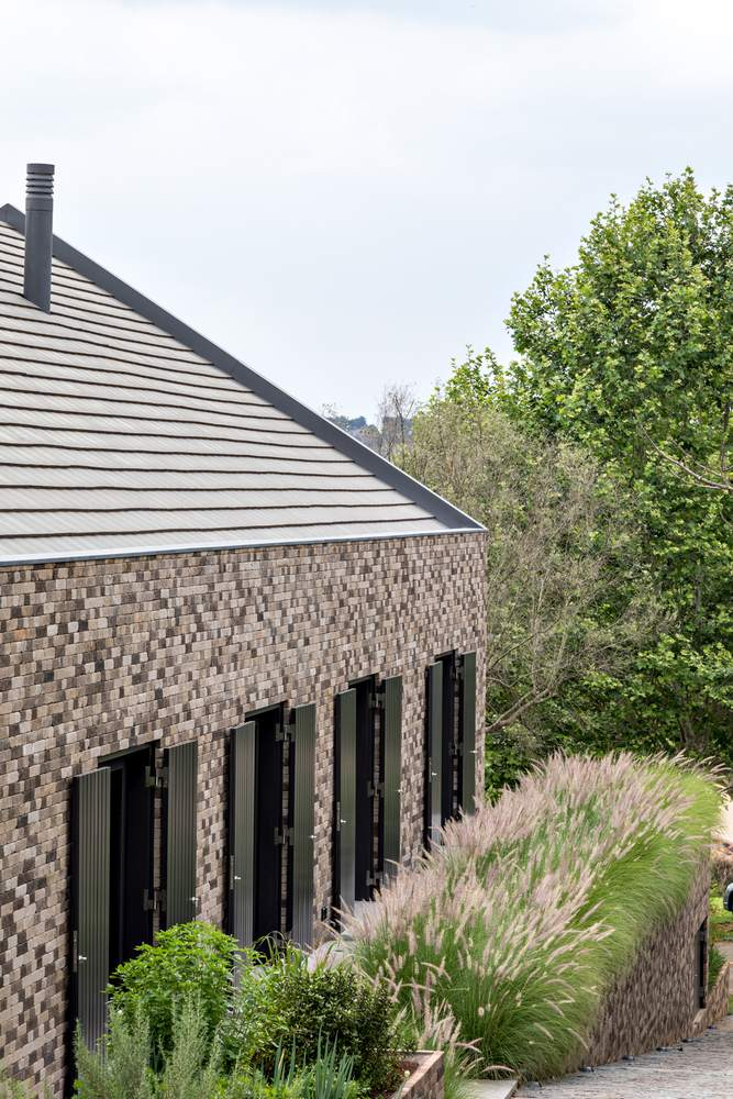 The buildings have a barn-like shape and a simplified design, with no overhangs on any side
