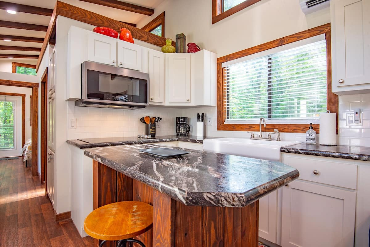 There's a window in front of the large farmhouse sink which frames a nice view and lets the light in