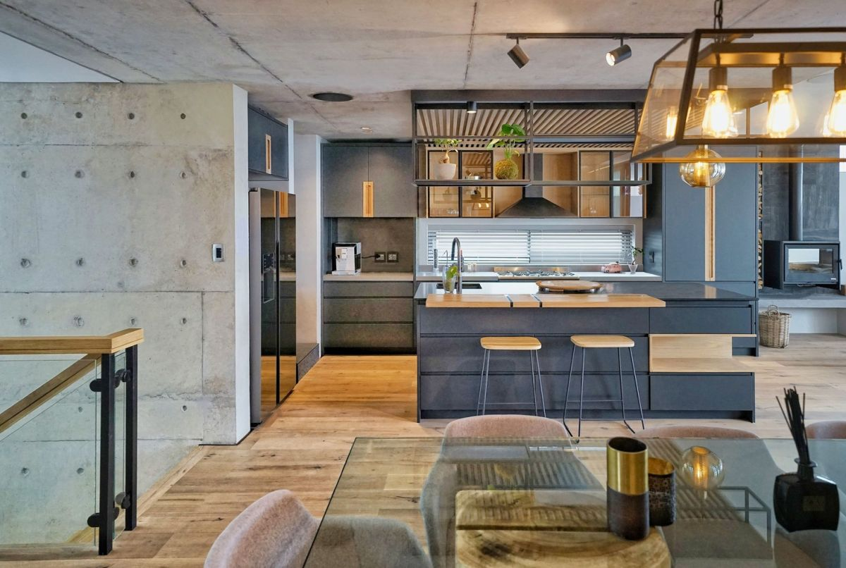 The open concept kitchen casually extends into the living area