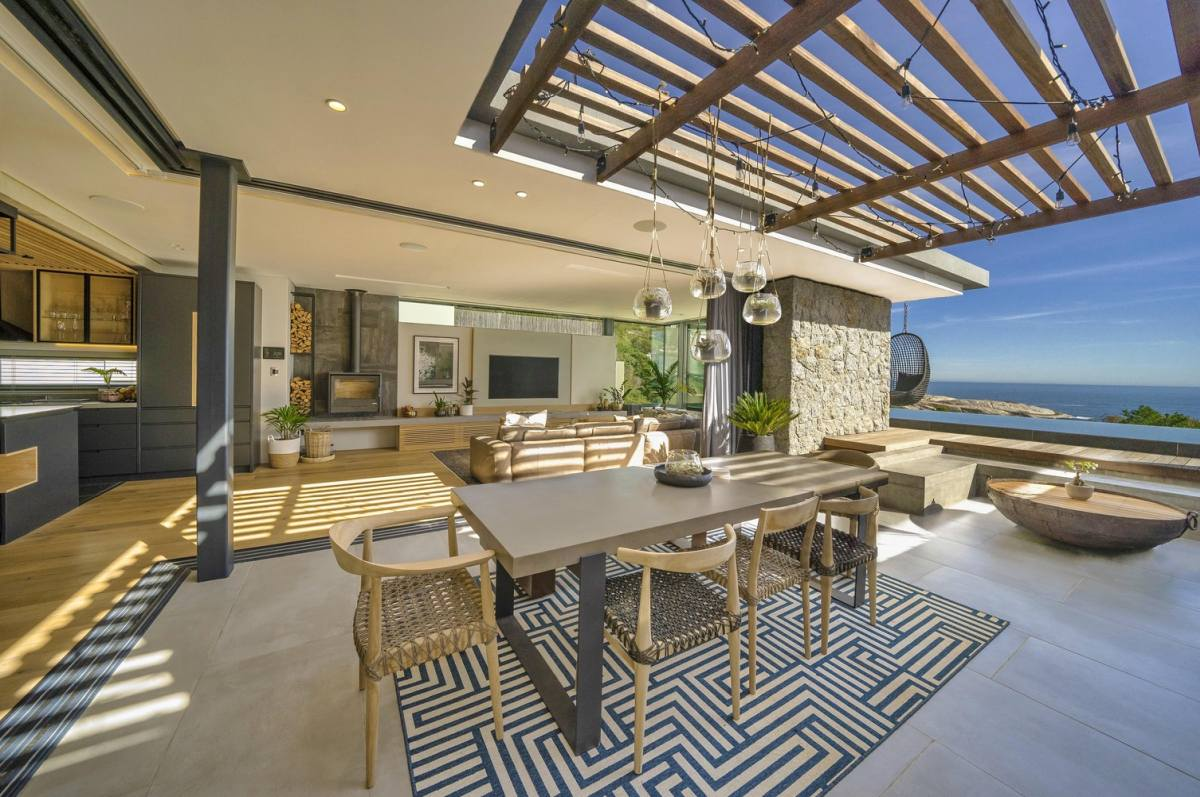Thr pergola complements an outdoor dining area that acts as an extension for the indoor living areas