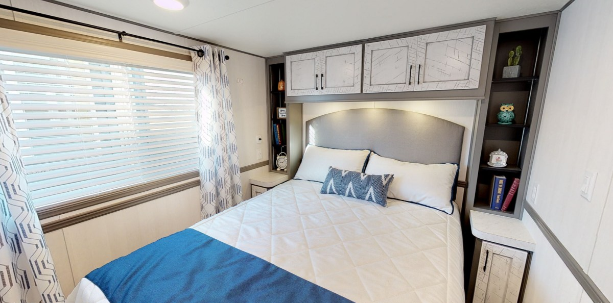 The downstairs are also has a bedroom with overhead storage, accent lighting and a large window