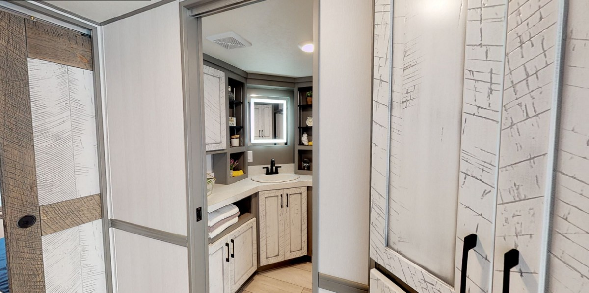 The bathroom is designed very similarly to the kitchen, with lots of cabinets for storage