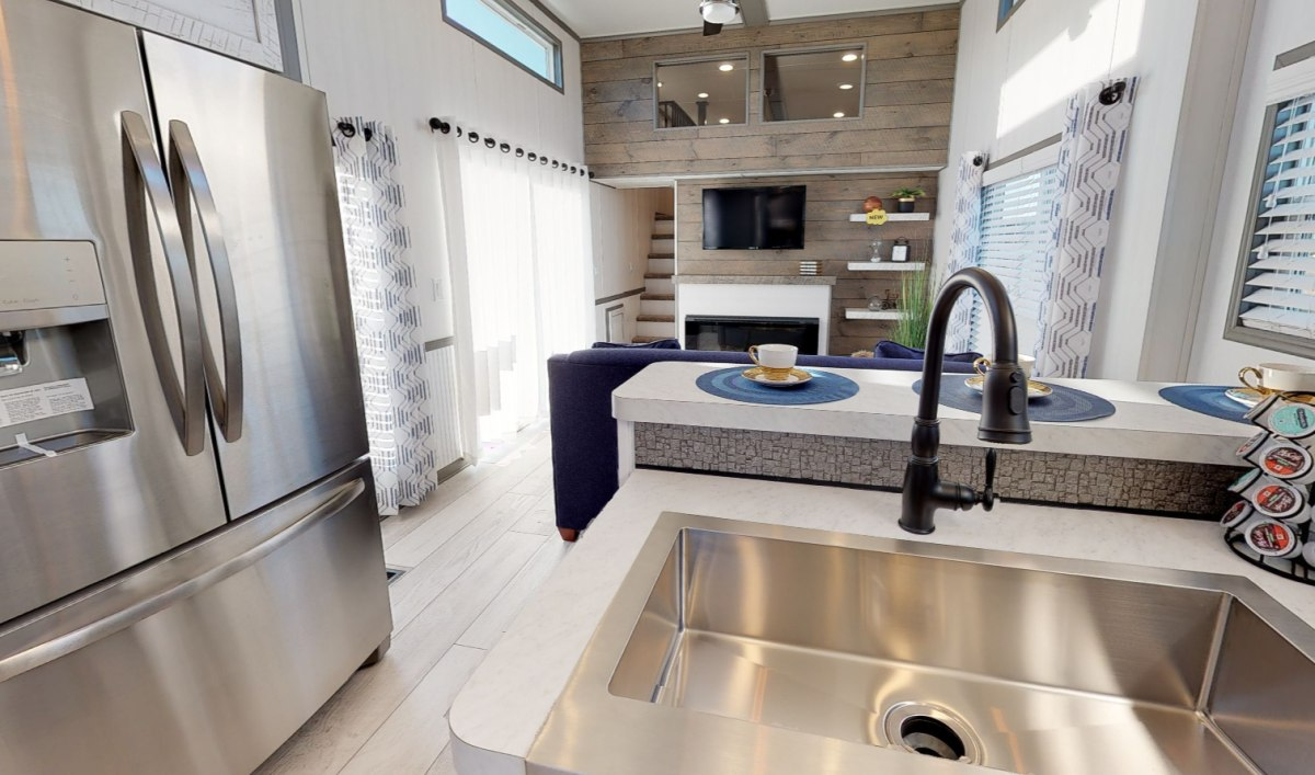 Inside, the kitchen and the living area are combined and have a very bright and spacious feel