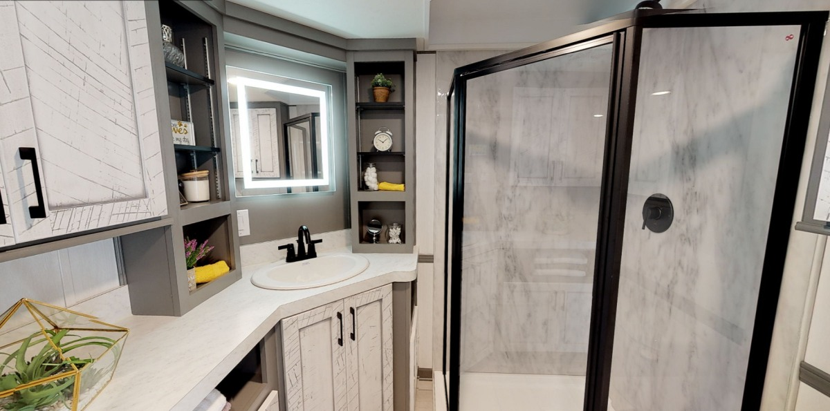 There's enough space in the bathroom for a shower stall and all the other basic features