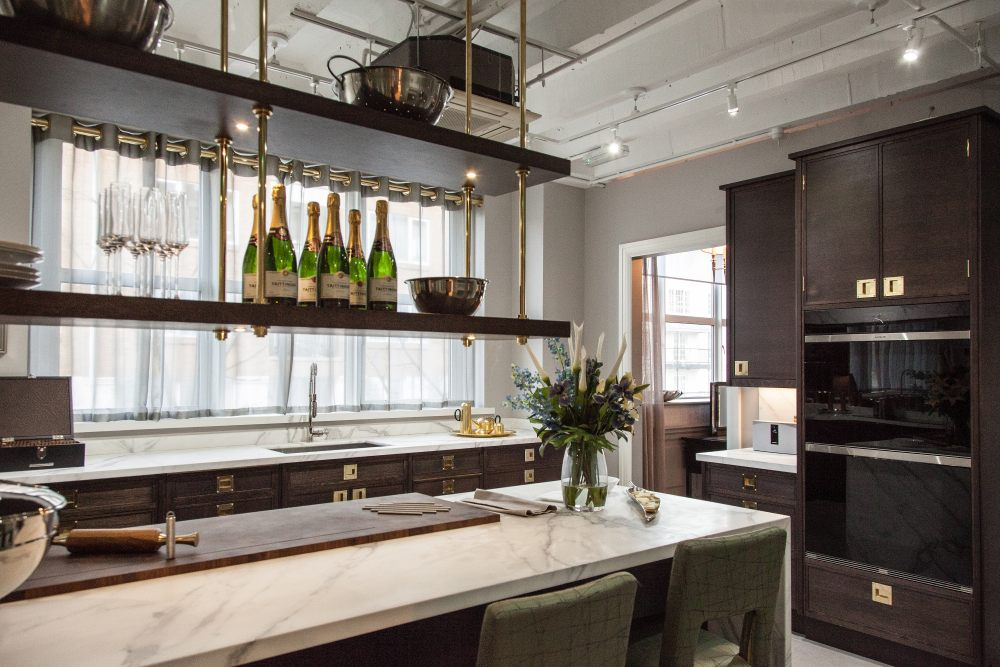 Kitchen island and hanging shelves above