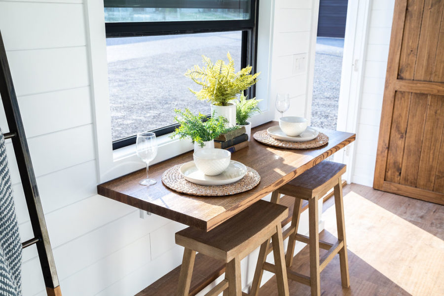 A small fold-down table is also cleverly placed in front of a window