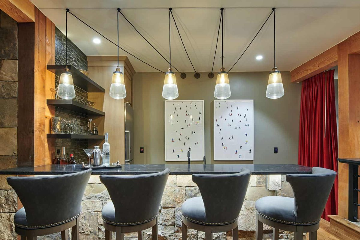 A beautiful wet bar complements the rest of the entertainment areas found on the lower level of the house