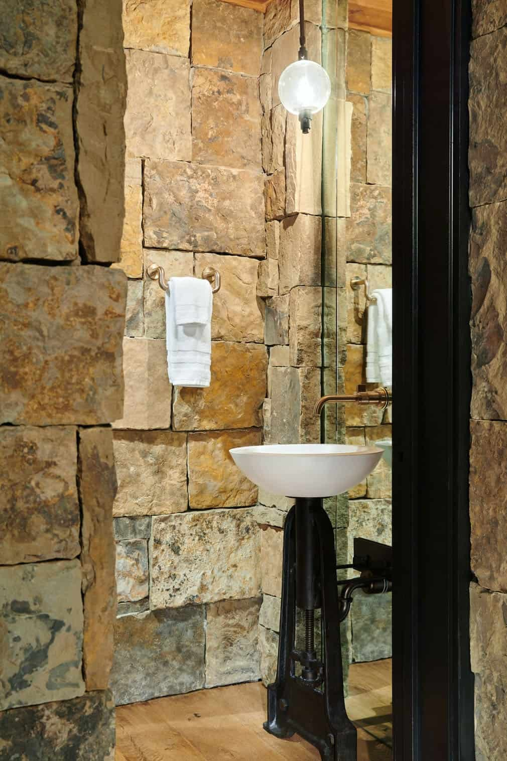 Stone was also used in other areas of the house like the bathrooms to create a unique and nature-inspired design