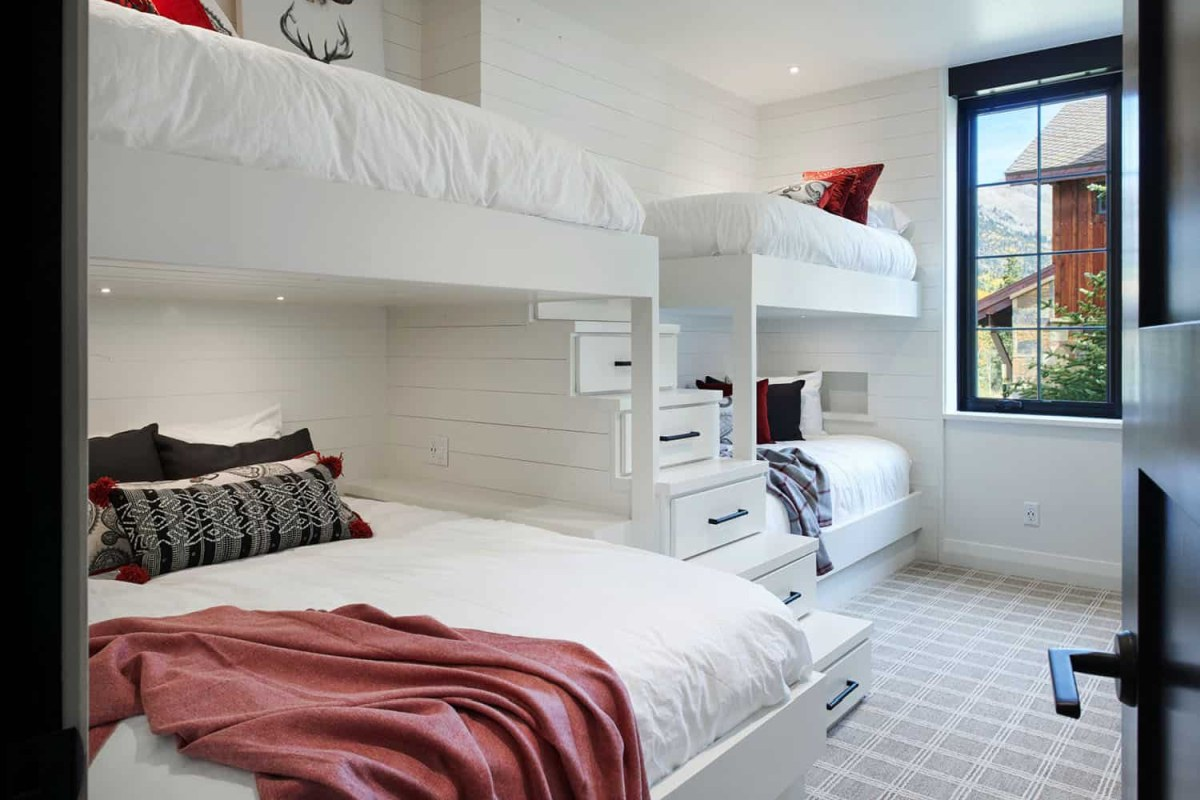 Bunk beds and storage stairs maximize the functionality of this particular bedroom