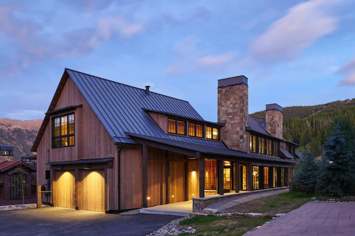The overall exterior design of the house is reminiscent of traditional barns and farmhouses