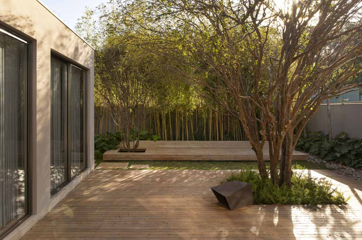 Large sliding glass doors allow access to the garden and the outdoor deck areas