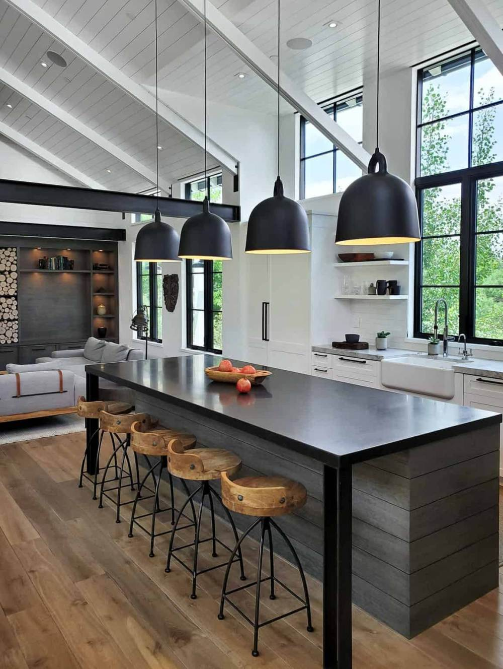 The kitchen island has an extended black granite top that allows it to double as a stylish bar