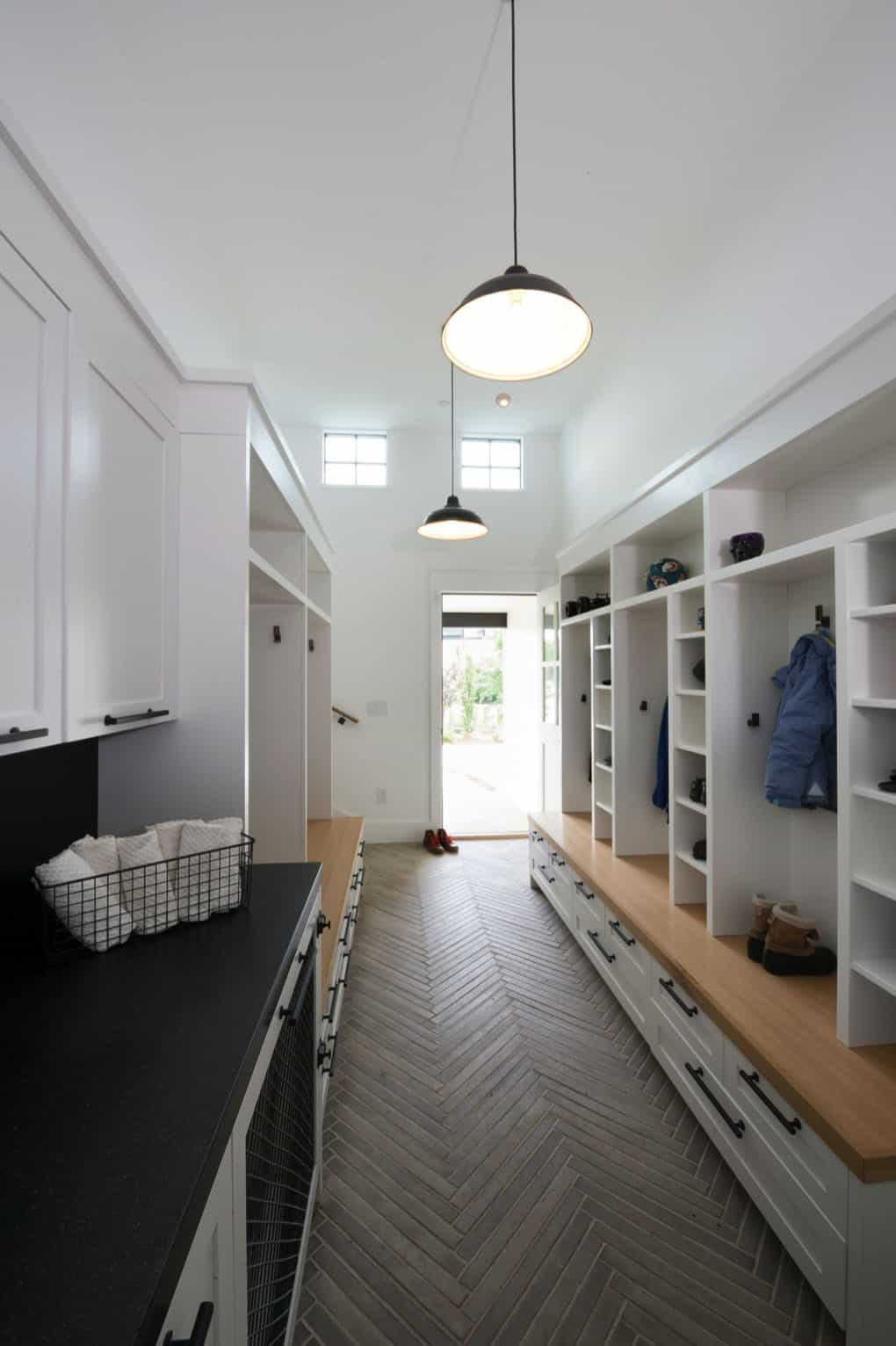 The entryway has a very farmhouse-inspired vibe as well, with plenty of storage and a lived-in look