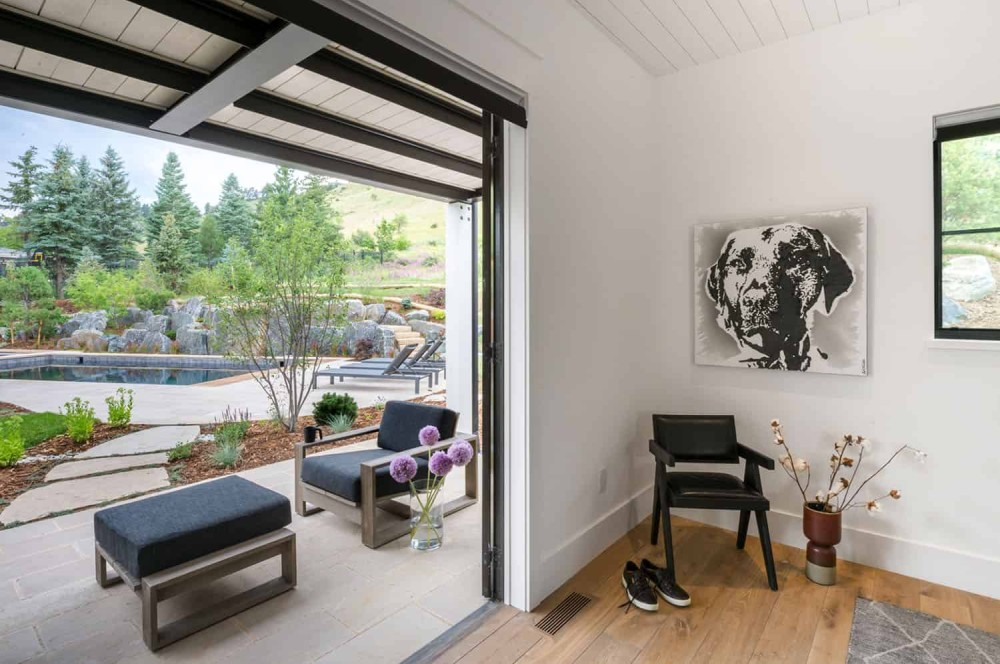 Sliding doors offer easy access into the garden and the courtyard from every section of the house