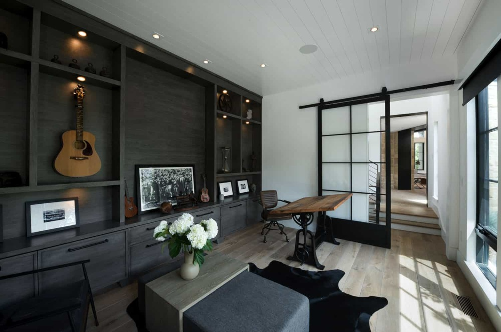 The color palette through the house is reduced to the classic black and white with subtle variations