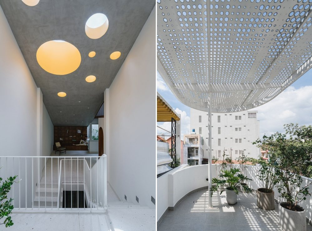 The top floor features a series of circular skylights as well as a perforated balcony roof that let natural light in from above
