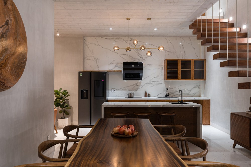 A live edge fining table and a marble accent wall this give space an elegant and refined look